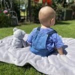 A baby and its teddy bear. Here are some must-have toys for 1 to 2 year olds.